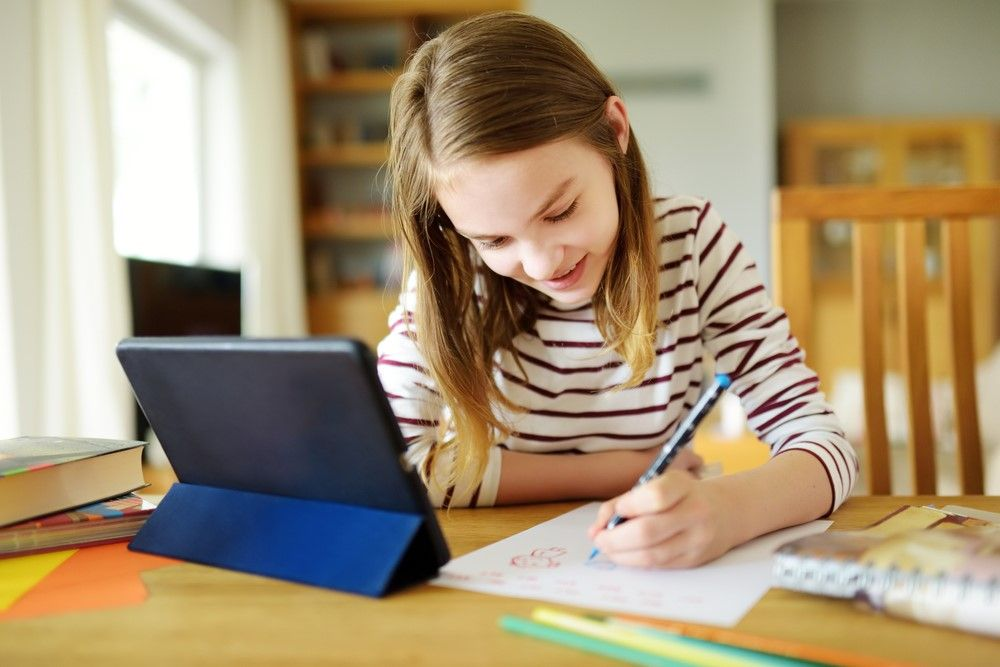 girl-doing-homework---april-2021